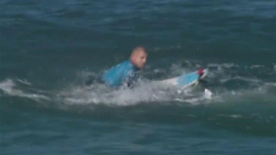 Surfing champ fights off shark attack on live TV