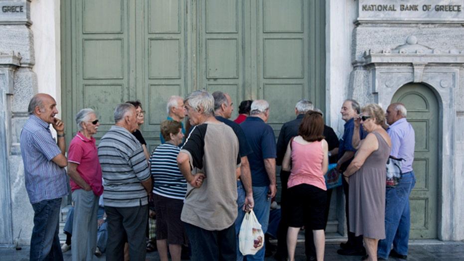 Banks in Greece reopen following debt crisis