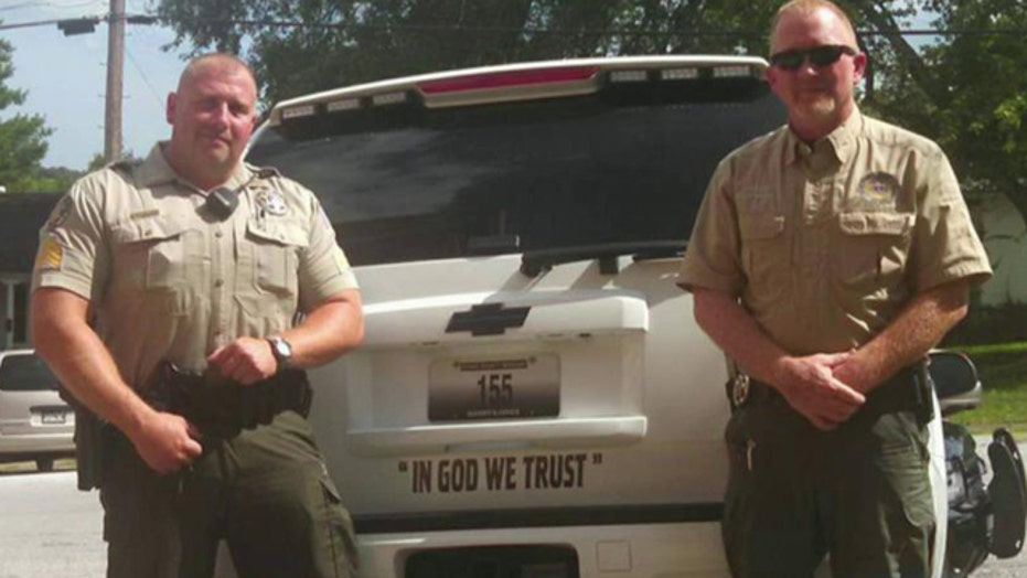 Atheists offended by sheriff's bumper-sticker salute