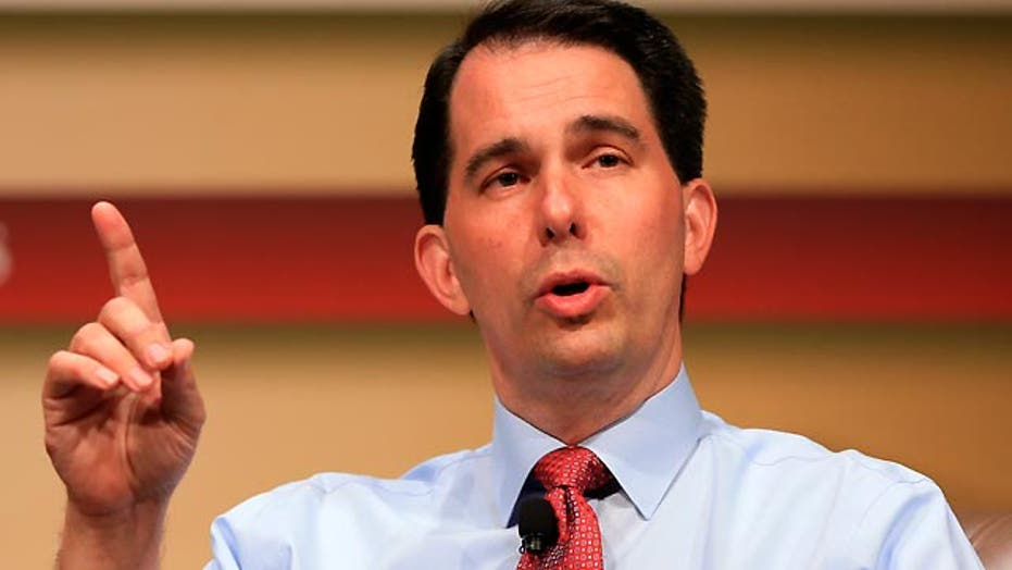 Gov. Scott Walker defends record against Trump attack