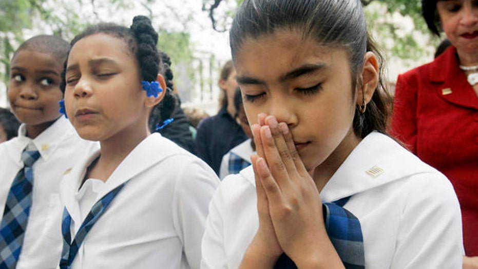 School district fined for opening assembly with a prayer