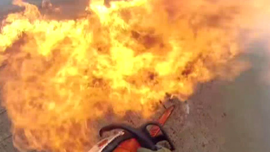 Into the flames: Firefighter's bravery caught on camera