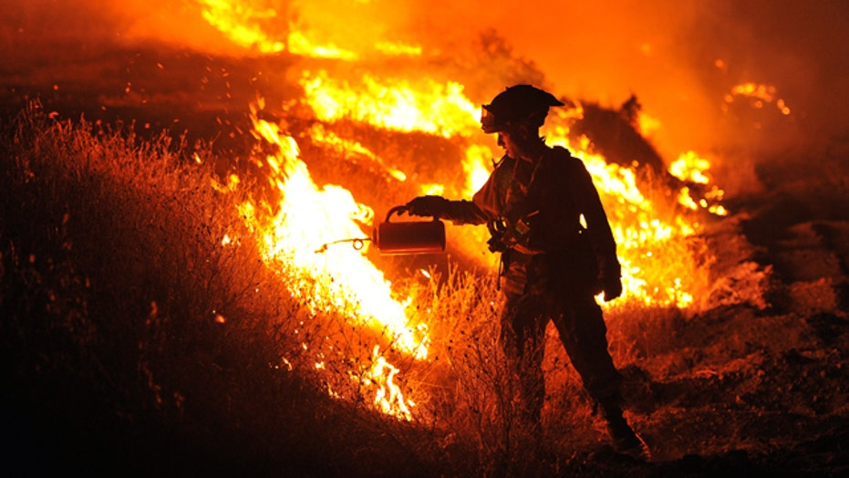 Firefighters battling more than 20 wildfires in Calif.
