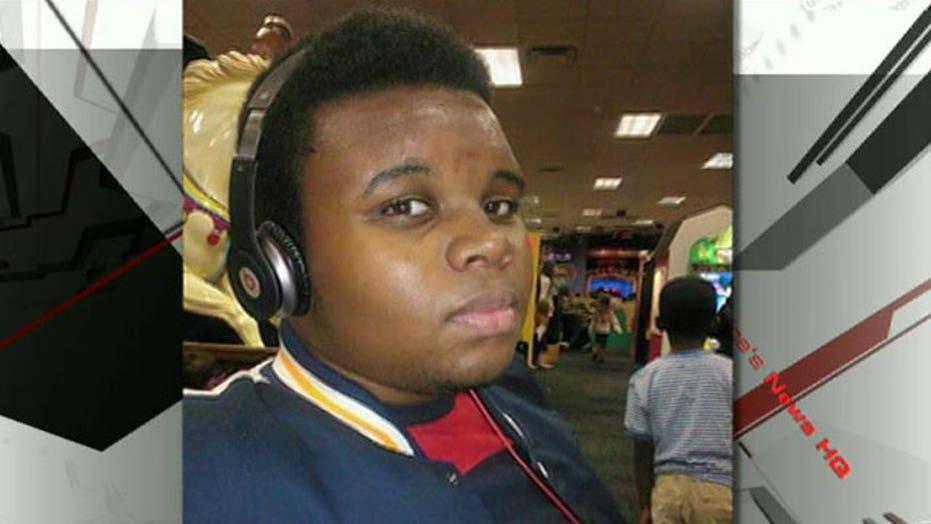 Ferguson demonstrators remember Michael Brown