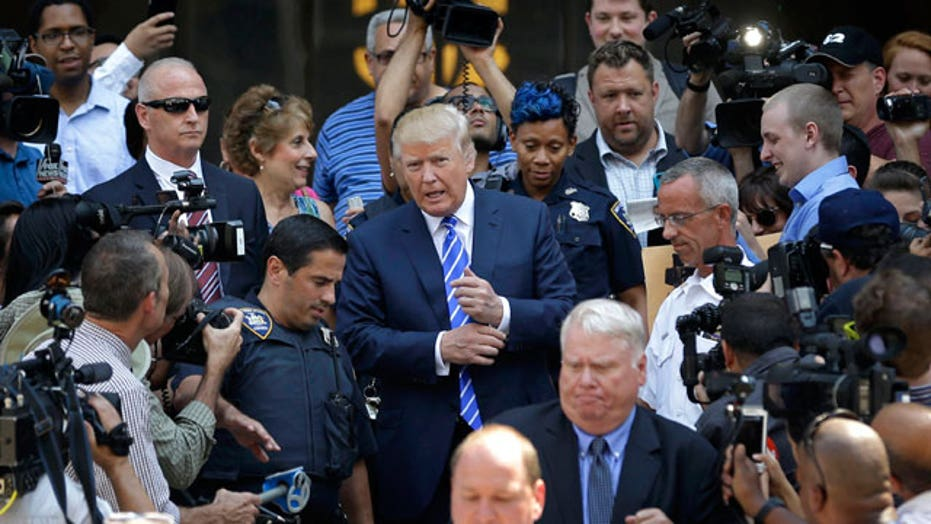 Media circus as Donald Trump reports for jury duty