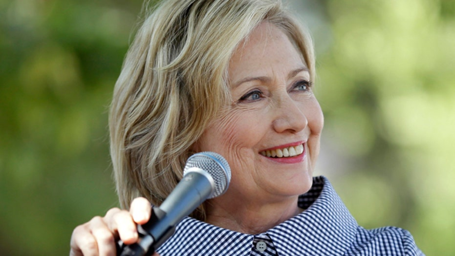 Is Clinton dismissing new developments in email controversy?