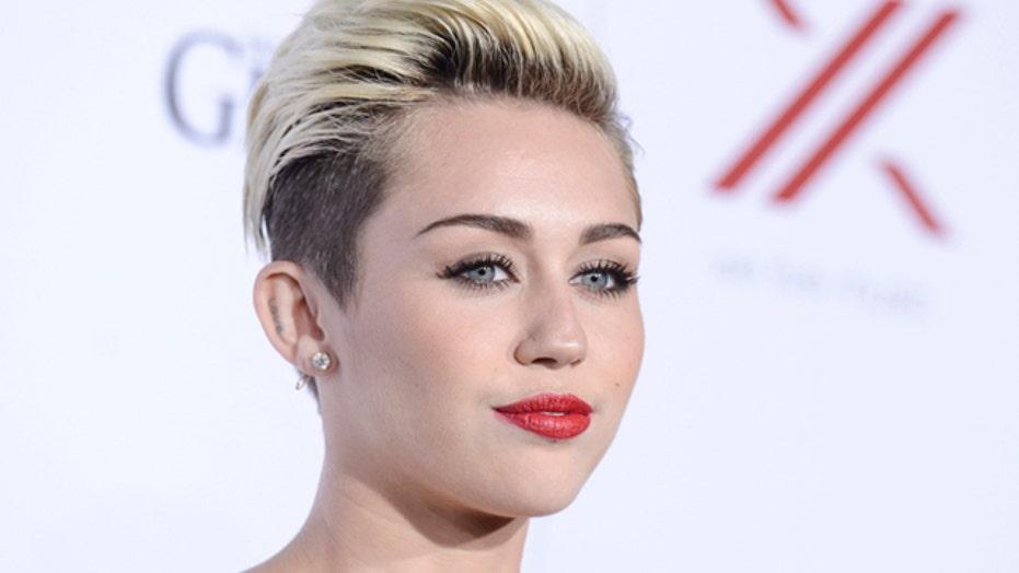 Raunchy Miley Cyrus shots building MTV buzz?