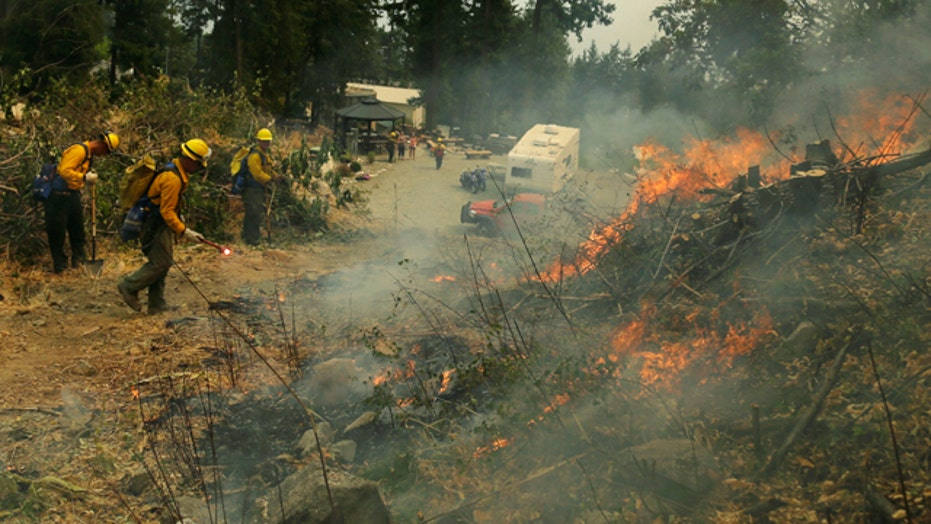 Blazes burning across dry West putting drain on resources