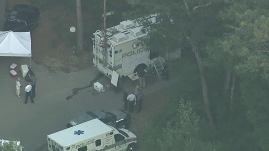 Cops: Officer shot at own police car