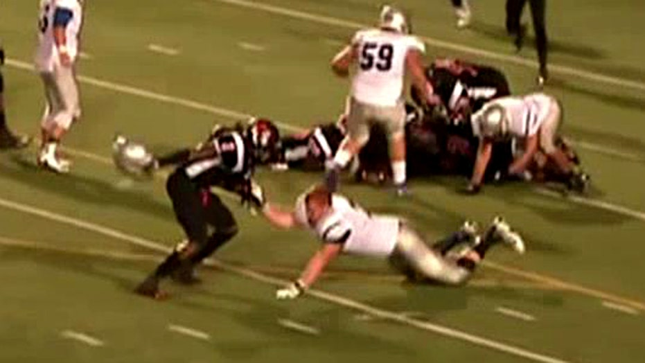 Offensive foul: Player hits opponent in head with helmet