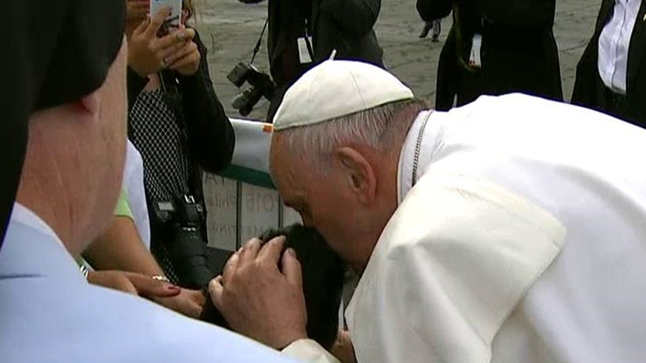 Pope Francis blesses young boy in a wheelchair