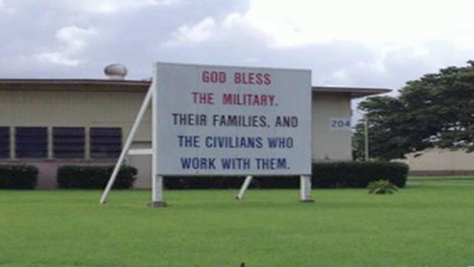 Group demands 'God bless the military' sign removed