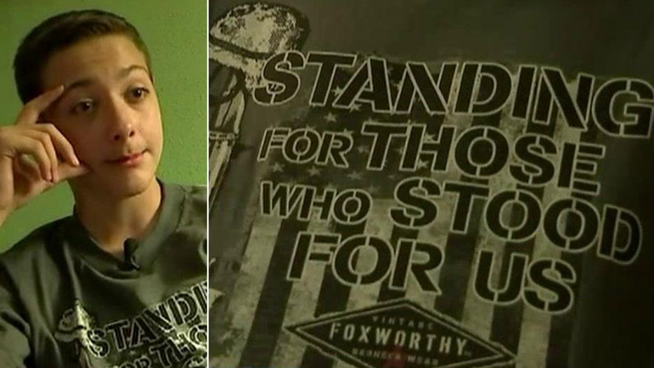 Boy suspended for wearing military T-shirt