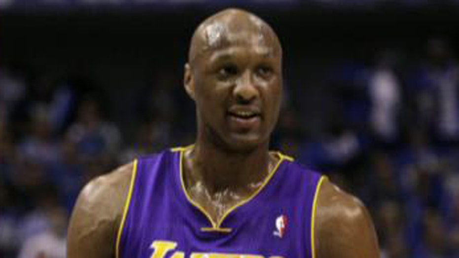 Family, friends rush to Lamar Odom's side at hospital