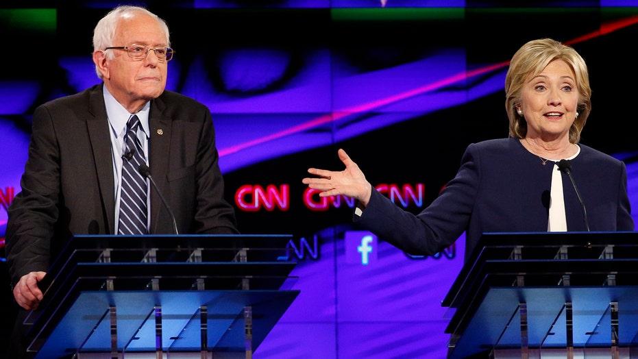 Clinton and Sanders dominate spotlight in first debate