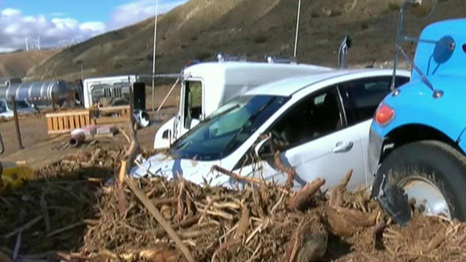 Vehicles trapped after mudslides hit major Calif. highway