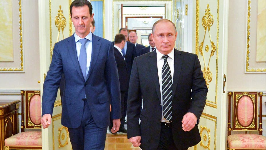 White House criticizes Moscow's warm reception for Assad