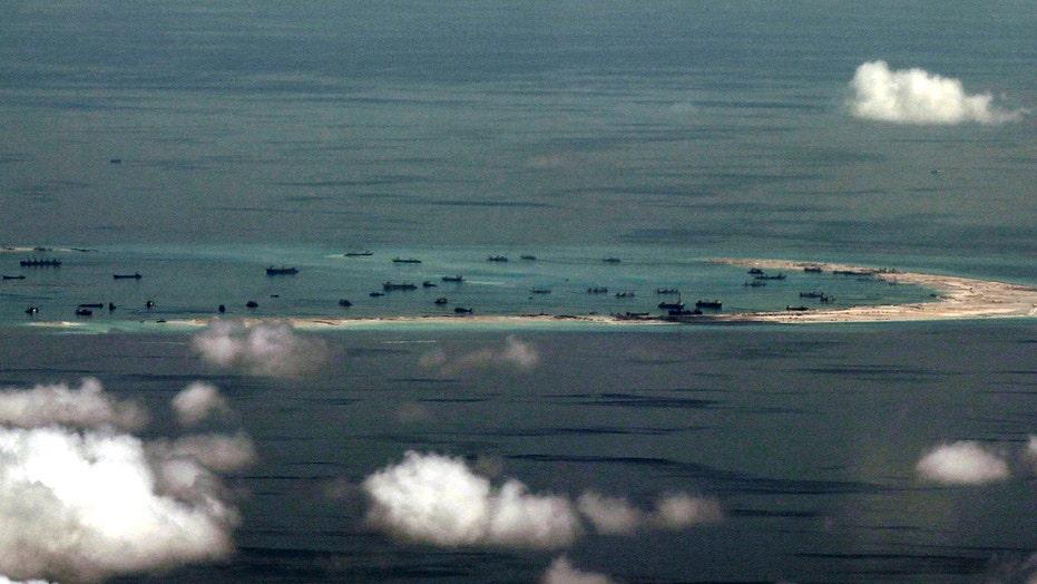 China warns US after Navy ship passes disputed islands
