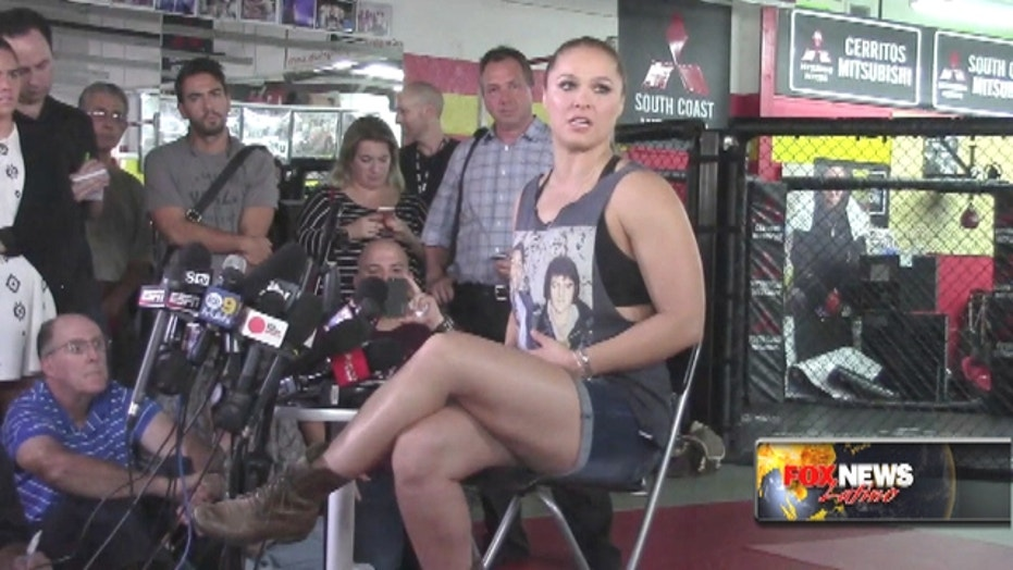 Ronda Rousey preps for Holly Holm with salsa music