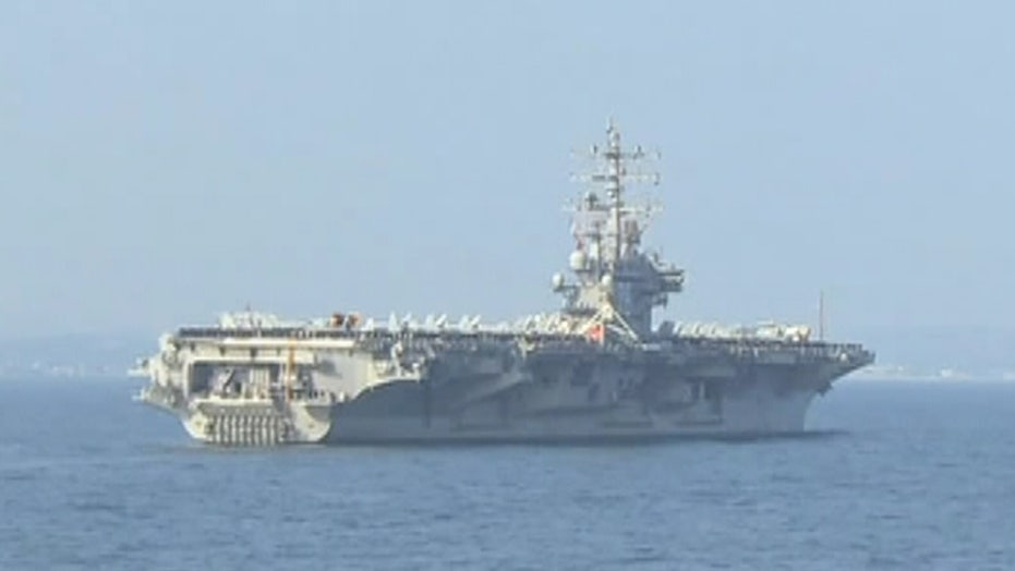 Russian bombers fly within one mile of US aircraft carrier