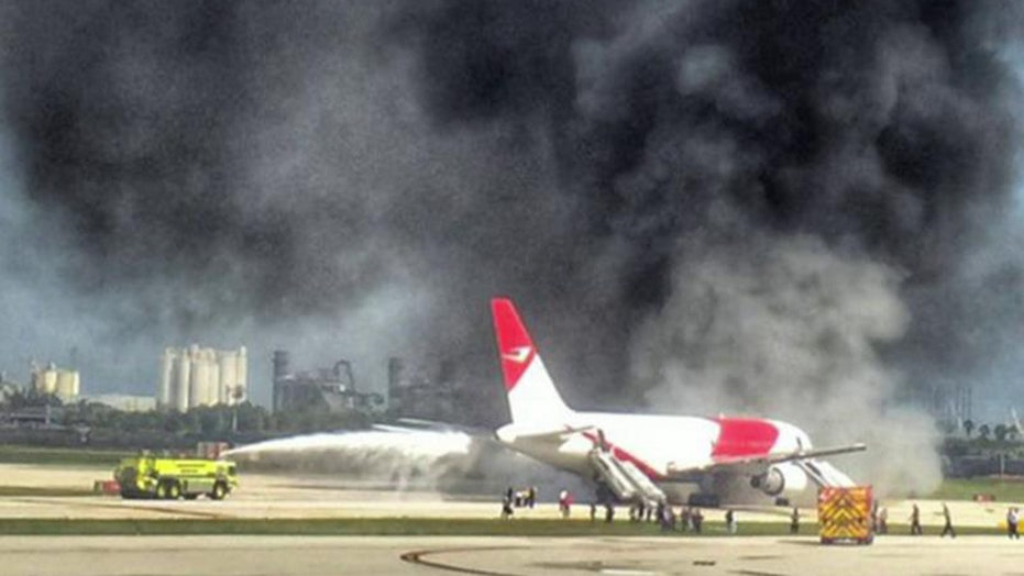 Plane catches fire, burns on runway at Florida airport