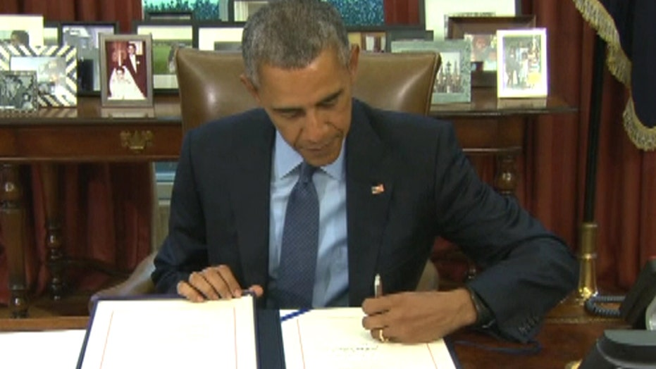President Obama signs 2-year bipartisan budget deal