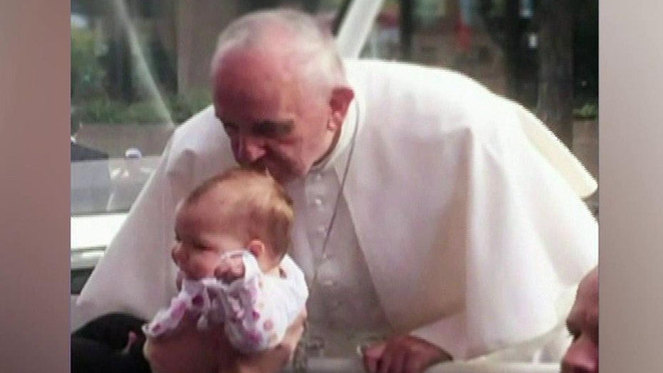 Baby's brain tumor shrinks after kiss from the pope