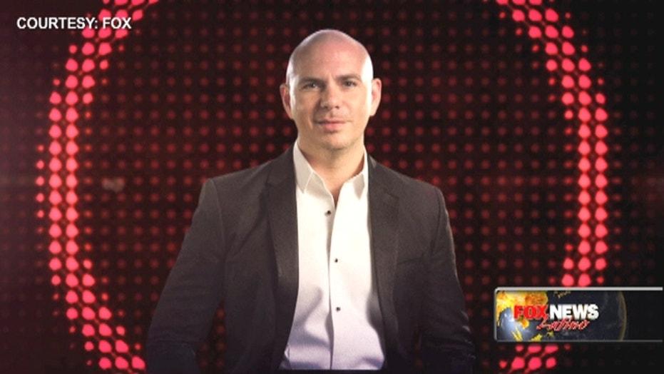 Fiesta! Pitbull brings in the heat to Miami's New Year