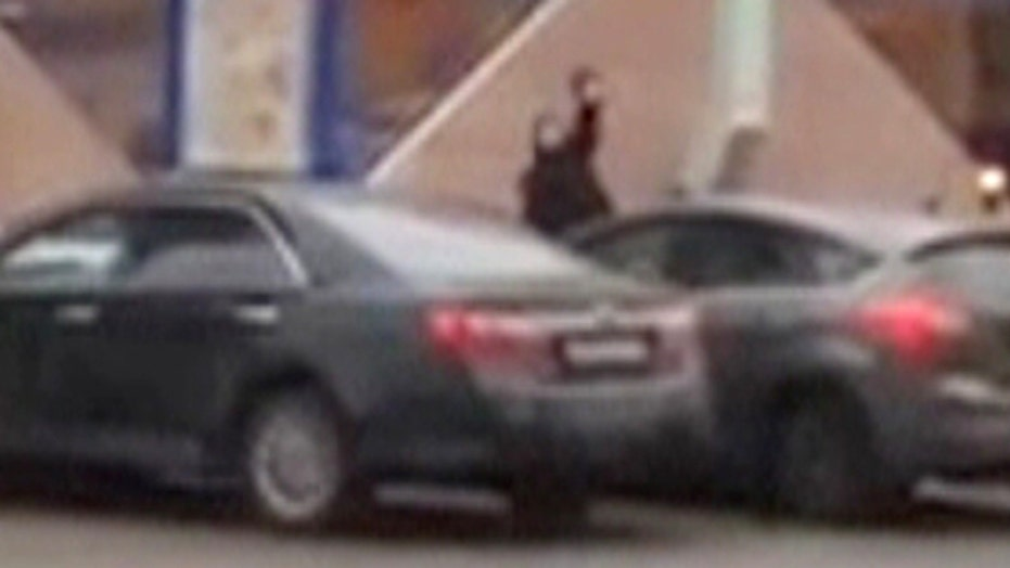 Warning, graphic video: Woman parades child's severed head