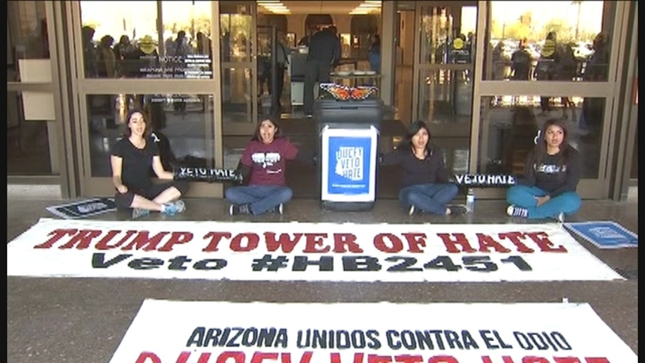 Protesters arrested for blocking governor's tower in Phoenix