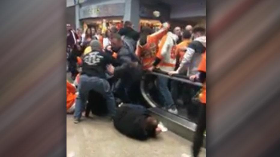 Malfunctioning escalator sends hockey fans flying
