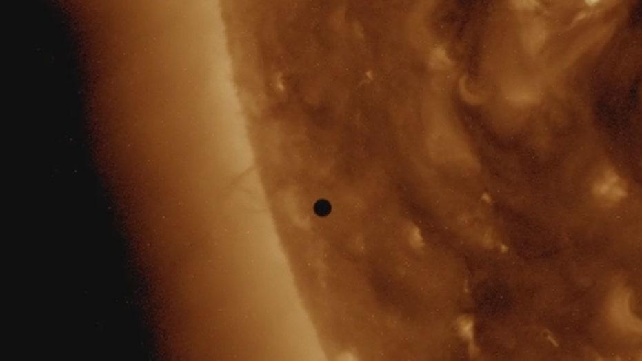 NASA video shows Mercury in 'transit' across face of sun