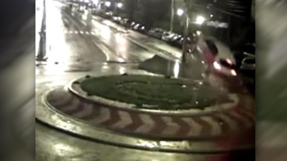 Speeding car hits traffic circle, flies through air