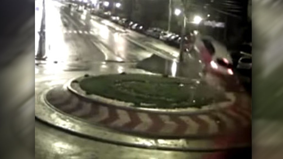 Speeding car hits traffic circle, flies through air