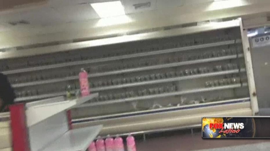 Hungry Venezuelans find empty supermarket shelves