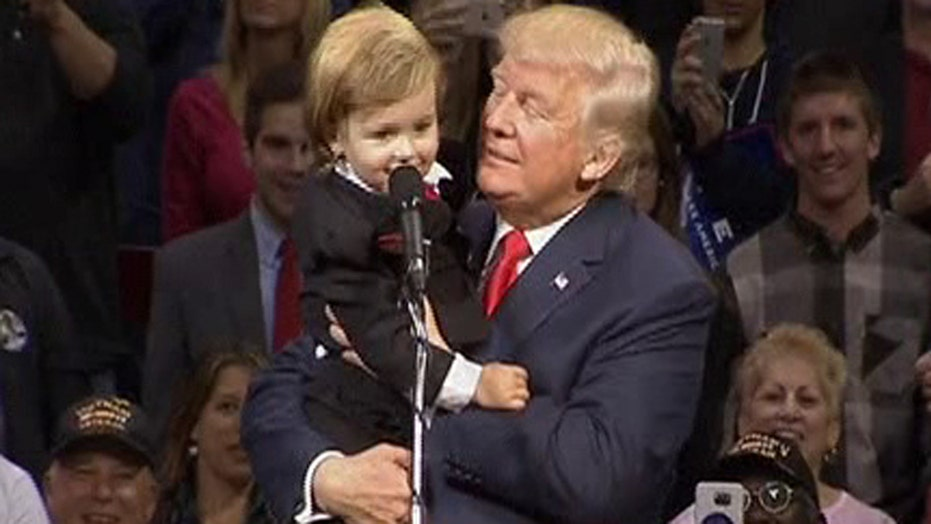 Pint-sized doppelganger joins Donald Trump on stage
