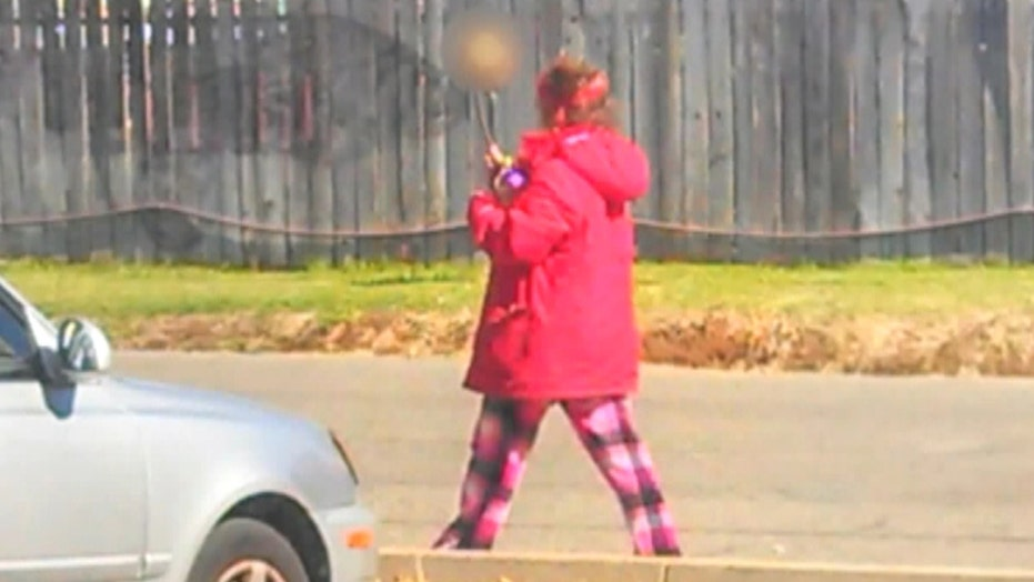 Woman carrying skull on stick leads police to human remains
