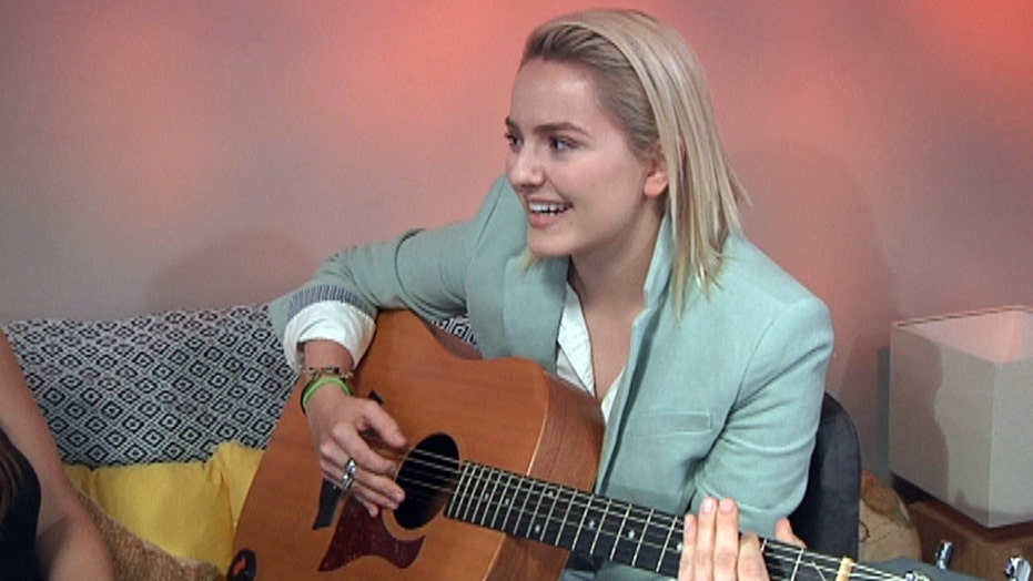 Songwriter says music helped beat depression