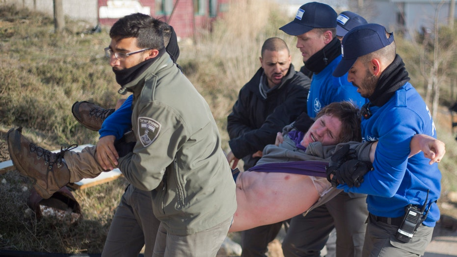 Evictions of West Bank settlers met with violent protests