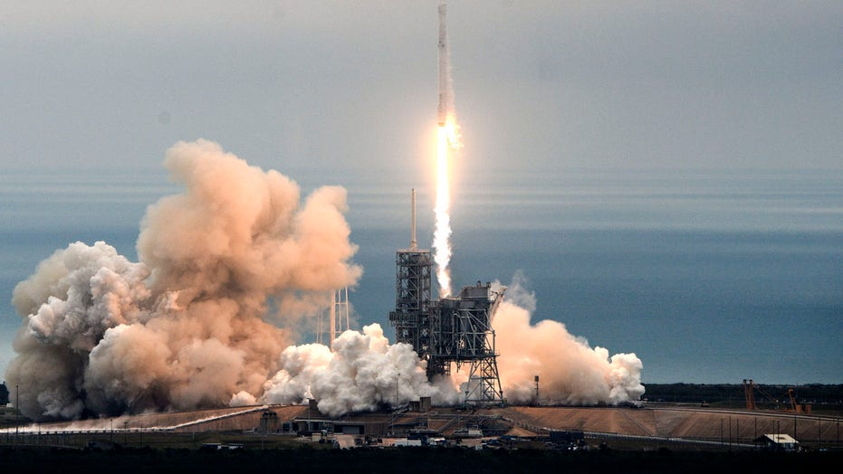 SpaceX to fly two people around the moon next year