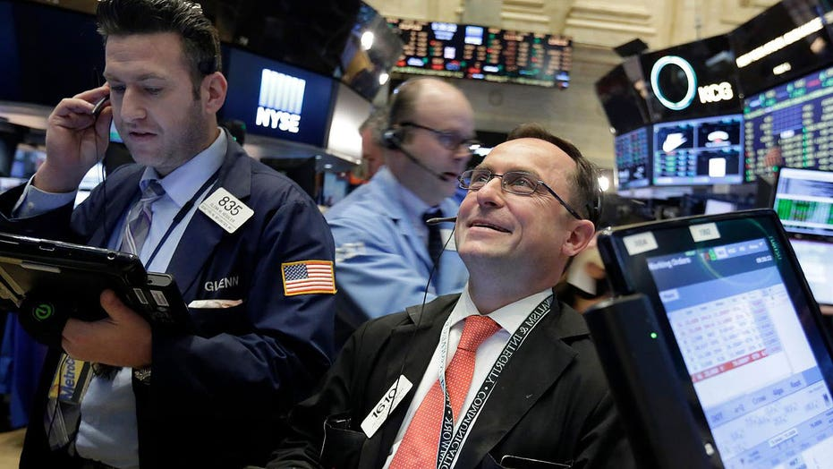 Stocks close a milestone week with more green