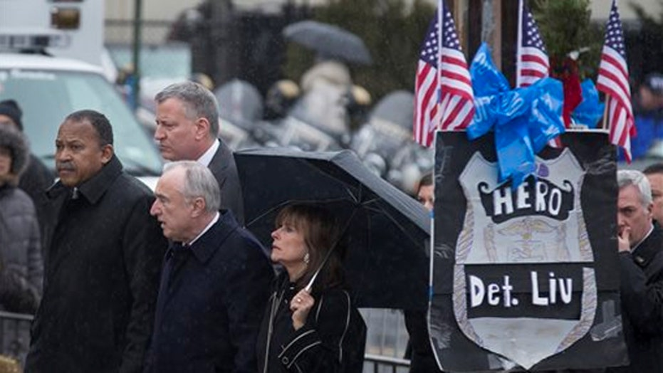 Family, dignitaries gather for the wake of NYPD Officer Liu