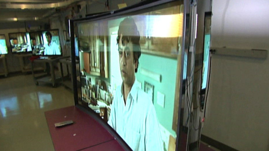 Curved TV screens, driverless cars on display at CES 2014