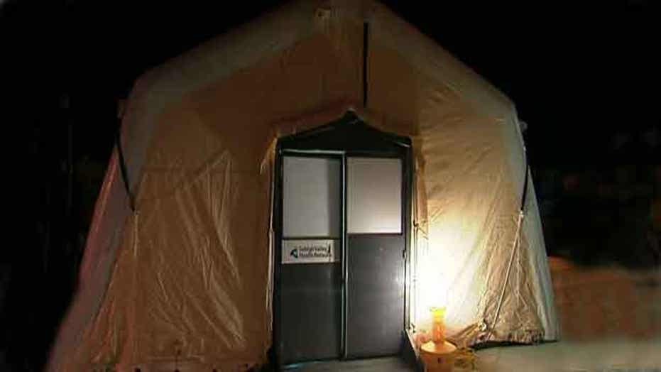 Hospital sets up tent to triage flu victims