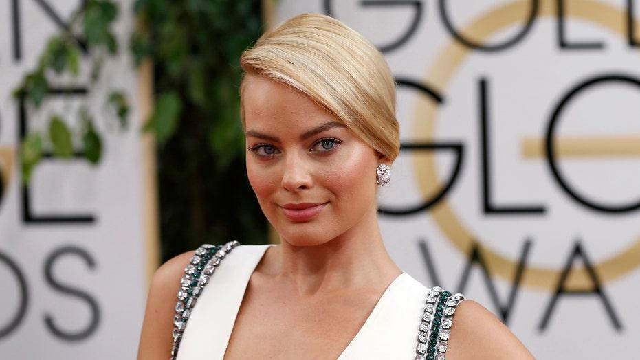 Get Margot Robbie's Sleek Bun Hairstyle