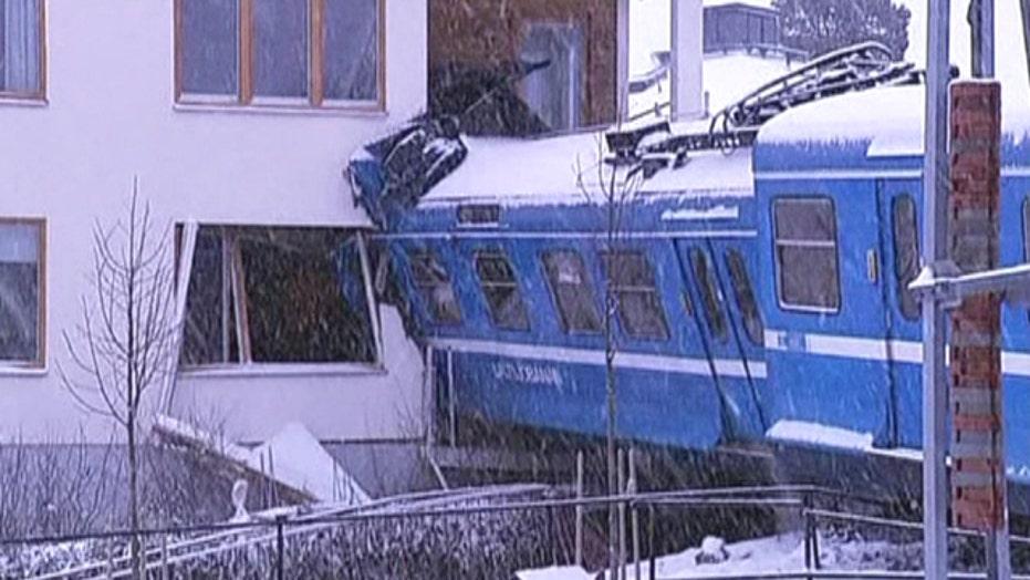 Stolen commuter train crashes into apartment building