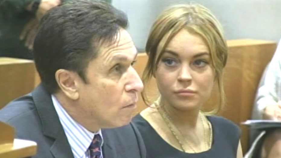 Why did Lohan switch lawyers?