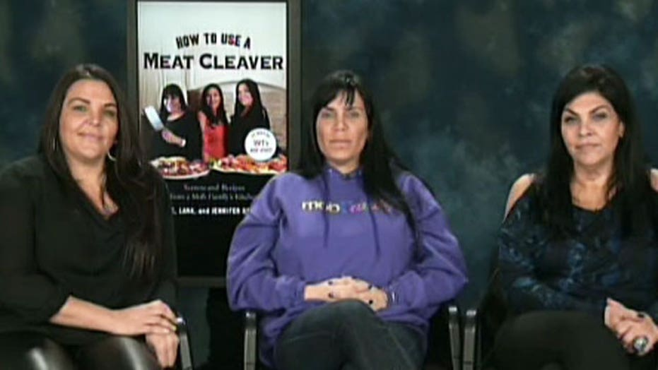 Mob wives demonstrate how to use a meat cleaver