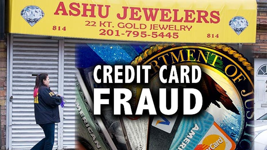 18 suspects charged in apparent $200M credit card scam