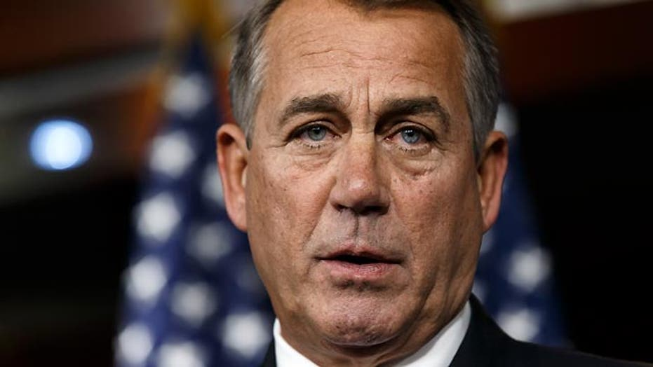 Squeezed by conservatives, Boehner blinks on debt ceiling